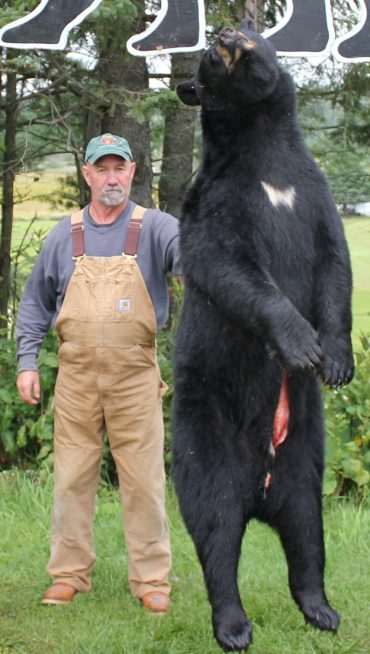 Black bear hunter with his trophy