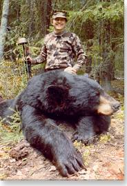 Bowhunter with his bear for the Pope and Young record book