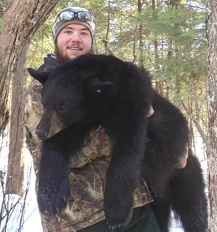 Brandon Bishop with yearling black bear