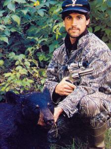 Doug Koenig's patience in the treestand finally paid of when he took this 225-pound bear running at 60 yards