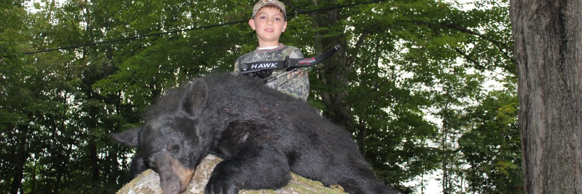Ten year old boy took a nice Maine bear with his bow
